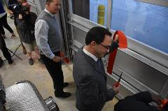 County Administrator, Craig Meadows, helps cut the ribbon at the Riner Fire Station Ribbon Cutting Ceremony